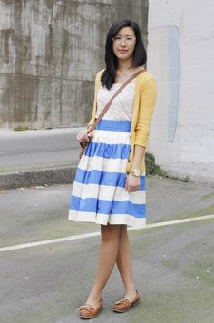 white lace, yellow cardigan, blue and white striped skirt