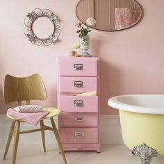 Think outside the box when it comes to bathroom storage. Here, an office filing cabinet has been given a new lease of life with a lick of bubblegum-pink paint - a really simple but effective decorating idea