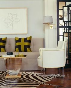kind of love the details...silk chartreuse pillows, zebra skin rug, mounted sconce, chartreuse welt on accompanying chair...