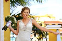 Beautiful and happy bride before her destination wedding at @secretsresorts in the Riviera Maya, bridal gown designed by @alvinavalenta . Mexico wedding photographers Del Sol Photography.