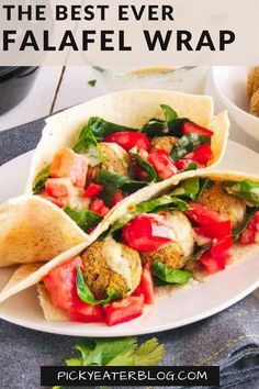 This Falafel Wrap Recipe is healthy comfort food at its best! Instead of fried these falafel patties are baked, then stuffed in a whole wheat pita and topped with spinach, tomato, and a creamy hummus.