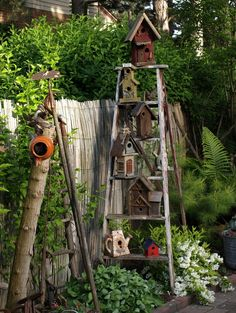 Great way to display birdhouses -> on a ladder