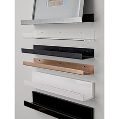 Shop metal aluminum wall shelf Sleek aluminum ledges with upturned edges play attention-getting supporting role for photos, artwork and objects of interest. Weather-proof brushed finish goes indoors and out. Fun to stagger down the wall.