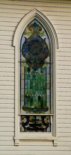 Gothic stained glass window in Sublimity, Oregon at the St. Boniface Catholic Church built in 1889 ~ by lechatbon on flickr