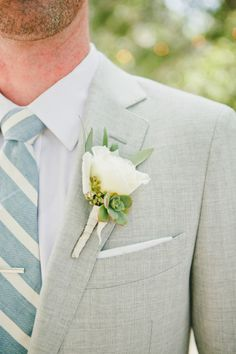 White rose and a succulent: http://www.stylemepretty.com/little-black-book-blog/2015/04/13/southwestern-style-santa-barbara-wedding/ | Photography: Onelove - http://www.onelove-photo.com/