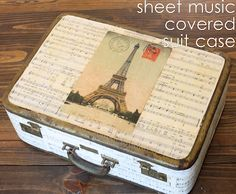 Sheet music covered suit case - The Graphics Fairy