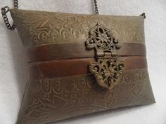 "No no Nanette, this is not a antique bag, it is a ""vintage"" bag from the 1970s to the 1990s. These types of bags were very popular in import stores. >>Antique - Solid Brass and Copper - Purse"
