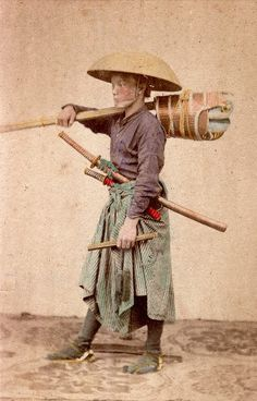 Samurai carrying kendo equipment.