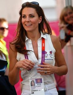 Britain's Kate, Duchess of Cambridge, leaves after watching a women's hockey bronze medal match between Britain and New Zealand at the 2012 Summer Olympics, London, Aug. 10, 2012. Britain won the bronze medal. (Jae C. Hong/AP Photo)