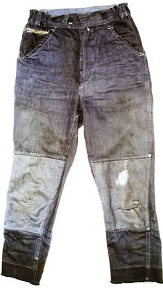 """These panel-patched trousers made of old French denim were described by Cosmo as """"an archetype of peasant clothing."""" This high waisted pair made for a woman or a child are from the late forties/early fifties when the influence of American workwear was growing, visible in the use of Levis-style rivets and leather re-inforcing of pockets."""