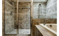 Save space by putting part of shower behind the vanity