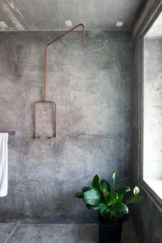 Cement washed walls, naked copper pipes, bathroom luxe