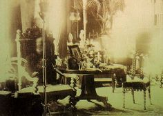 This well known photo—and perhaps one of the oldest examples of a bonifide spirit photo—was taken in the Combermere Abbey Library in 1891 by Sybell Corbet. The exposure length was approximately one hour, and the figure of a man appears to be sitting in the armchair located in the foreground (it's difficult to make out, but a head and arm can just be made out sitting in the chair). At the time this photograph was being taken, Lord Combermere (a top British cavalry commander) was being buried f...
