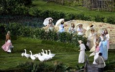 Actors (and fowl) perform during the opening ceremony Friday at the 2012 Summer Olympics,