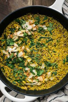 An easy one-pan meal that features turmeric quinoa cooked with coconut milk and kale for a creamy and filling vegan/gluten-free dinner.