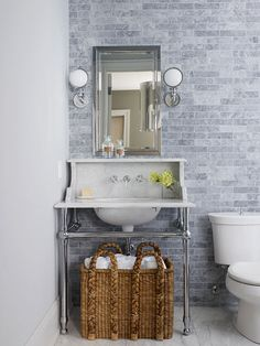I like the grey subway tiles. Bathroom Basics ~~ Small bathrooms usually lack storage options, so use baskets to add storage and decoration. A large basket stores extra towels within easy reach in this powder room. Beautiful Bathrooms, Modern Bathroom, Master Bathroom, Small Bathrooms, Coastal Bathrooms, Minimalist Bathroom, Bathroom Renos, Bathroom Storage, Design Bathroom