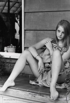 Young Jodie Foster in a stunning black and white photo.