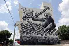 Street art  in Cozumel, Mexico, by British artist Phlegm (for SeaWalls 2015). Photo by Rom Levy.