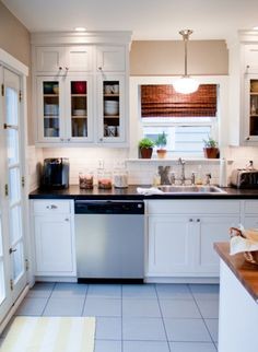 on the to do list: add molding to my boring cabinet fronts to make them look like these.
