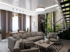 Cozy Living Room Under Open Staircase With Large Round Pendant And Gray Armchairs Also Small Coffee Table On Black White Rug Added