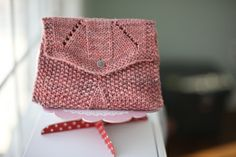 This version of the 'Sundance Make Up Bag' by Joëlle Meier Rioux was made by those clever sisters from the blog site Nice and Knit. This is a FREE pattern download via Ravelry