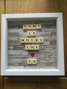 A Beautiful and unique box frame that makes a wonderful gift. A beautiful frame with a decorative background,embellished with scrabble tiles and a red heart, this really does make a unique and special gift for any home! All items are hand made to order, so please allow up to 10 working days from date of order if possible we will try to dispatch sooner, this does vary, depending on our work load. The frame is sent second class signed for so will take approx. 3-4 working days for delivery…