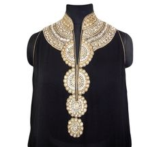 The kurta is made in pure georgette with gold lame borders and Swarovski work around the neck. The kurta can worn along with a pair of gold shimmer or black shimmer churidar