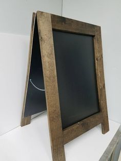 Beautiful, rustic handmade built to last sandwich chalkboard. Great for any business, wedding, or any occasion or event. Heavy duty construction, built to last a long time. Handcrafted: All of my sidewalk chalkboards are handcrafted by me. Very solid design made of solid wood. Frame is 3.5 inches wide for additional strength. Buy with confidence, built to last. Sidewalk chalkboard weighs 26 pounds making it stand up in strong winds and weather. Choose your stain color from the drop down menu. Th Outdoor Chalkboard, Chalkboard Easel, Large Chalkboard, Chalkboard Signs, Chalkboards, Sandwich Board Signs, Liquid Chalk Markers, Easy Writing, Party Bus