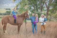 Totally doing this when I get a Palomino:)  family photography poses field horse