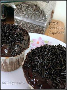 Triple Chocolate Cupcakes | Easy cupcake recipes   When theres chocolate the chocolate lovers go absolutely overboard. But for a person like me any excess chocolate (or even a tiny bit unless its Lindt) puts me off. The kids had been asking for a decadent chocolate cupcake - bakery style especially after the elder one saw I was making a post on hosting chocolate delights !  So adapted Gayatris recipewith some changes halved it (or should I say made 1/4 of the recipe) made exactly 4 cupcakes…