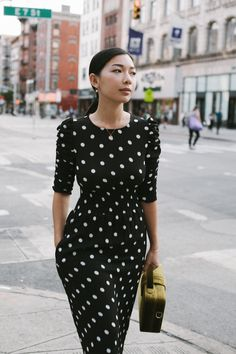 Blogger, Honey and Silk, shows that polka dots never go out of the style in this black long dress from the #HMFallFashion collection. | H&M OOTD