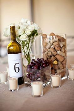 Mixture of wine bottles, lanterns, floral arrangements, corks