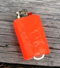 mini BIC lighter with duct tape:This tricked-out Bic has a pop top attached, and is wrapped with about five feet of duct tape.
