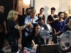 Odile demonstrates the look for the @Joe Jonge Altuzarra show to her team.