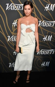 Ashley Tisdale in a cream bow-tied strapless midi dress