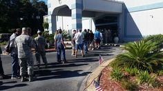 Homeless men and women, veterans and non-veterans alike, line up to get into Striving for Perfection Ministries to participate in Friday's eighth annual Homeless Veteran's Stand Down.