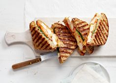 This panini turns leftover roast chicken (or turkey) into a quick lunch or light dinner. Serve with crudit?s or a tossed salad to complement the richness of the cheese. No panini press? No problem. Cook in a grill pan over medium heat, pressing and turning once.