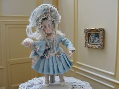 unknown artist - porcelain girl holding doll