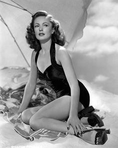 geraldine fitzgerald posing under an umbrella in a swimsuit | 1940s | #vintage #1940s #fashion