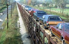 Trainload of 1969 Oldsmobiles  departing from the Lansing,MI factory