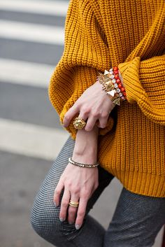 gold with a pop of coral. Love the color of sweater too.