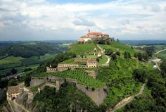 Riegersburg Castle rises from the rocks of a volcanic mountain and offers a wonderful view over the magnificent vineyards of southeastern Styria, Austria