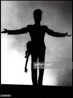 Prince in silhouette performs on stage on the Diamonds Pearls Tour Ahoy Rotterdam Netherlands 27th May 1992