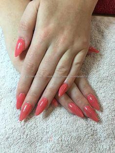 Acrylic nails, stilleto shaped nails with Snap dragon gel polish