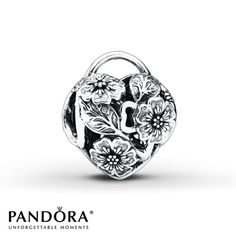 Six-petaled blossoms and leaves adorn this heart-shaped lock charm from the PANDORA Autumn 2014 collection. This romantic charm is crafted of sterling silver. Style # 791397.
