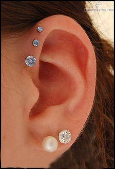 Helix Piercing   Ear Triple Anti Helix and Dual Lobe Piercing
