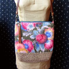 Handmade one of a kind vintage floral cotton purse with adjustable leather strap.