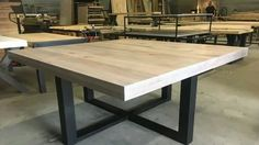 i want a dining table and sofa table stained gray with stainless steel legs like this with maybe a SS design on top that looks like a large droplet of paint Large Square Dining Table, Glass Dining Room Table, Slab Table, Metal Dining Table, Dining Table Design, Dining Room Sets, Living Furniture, Metal Furniture, Home Decor Furniture