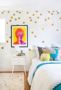 Fun, bright room with gold polka-dots: http://www.stylemepretty.com/living/2015/03/09/playful-tween-bedroom-with-gold-dots/ | Photography: Tessa Neustadt - http://tessaneustadt.com/