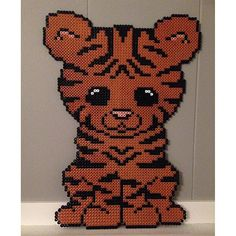 Tiger hama beads by _camillalind - Pattern: https://de.pinterest.com/pin/374291419013031036/